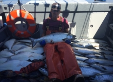 Ben Harris and a pile of fish